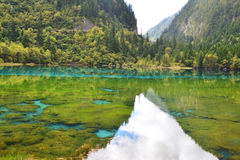 Blue lake. With mountain reflection Stock Photos