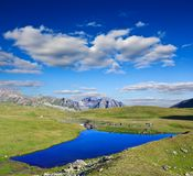 Blue lake in a mountains Stock Images