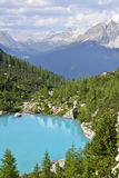 Blue lake and mountains. A beautiful panorama with a blue alpine lake and the peaks all around it Stock Photography