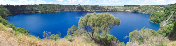 "Blue Lake Mt Gambier. A panorama of the amazing blue lake at Mount Gambier. The volcanic crater was formed by the last eruption 5000 years ago and provides a "" Royalty Free Stock Photos"