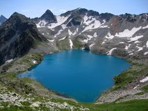 Blue Lake of Murundzhu. Blue Lake - one of two lakes in the Murundzhu valley, North Caucasus Mountains, Russia Royalty Free Stock Image
