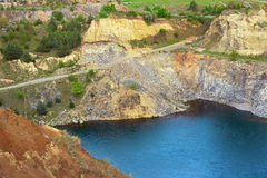 Blue lake in old abandoned quarry Stock Images