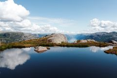 Blue lake reflecting clouds in mountain Stock Image