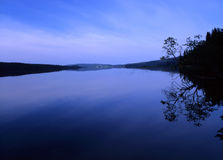 Blue lake reflection Royalty Free Stock Photos