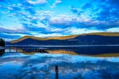 Blue Lake Reflection. Clouds reflecting in Okanagan Lake at dusk Royalty Free Stock Photography