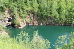Blue lake. Blue small lake in deep forest Royalty Free Stock Photos