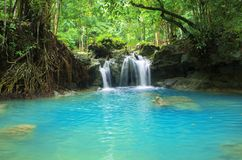 Blue lake and small waterfall. Bright exotic nature with fresh water stream. Stock Photography
