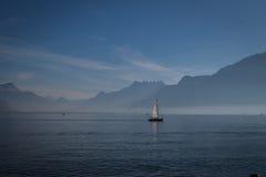 Blue lake. Small yacht on Geneva lake Royalty Free Stock Photo