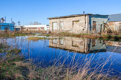 Blue lake in a spring day and old building. Background Stock Photo