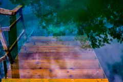 A blue lake with stairs down. Kazan, Russia royalty free stock image