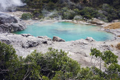 Blue lake with steam clouds Stock Images