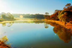 The blue lake sunrise Royalty Free Stock Photos