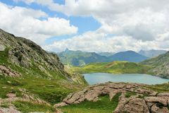 Blue Lake Surrounded by Green and Gray Grass Field Royalty Free Stock Photography