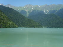 The blue lake surrounded by mountains Stock Images