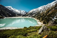 Blue Lake Surrounded by White Snowcapped Mountain Stock Photo