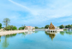 Blue lake with Thai-style golden pavilion Royalty Free Stock Images