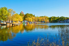 The blue lake water and pavilion autumnal scenery Royalty Free Stock Photography