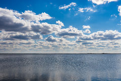 Blue lake water and sky beautiful cloud.  stock images