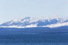 Blue lake waves mountain snowcap reflection Stock Photography