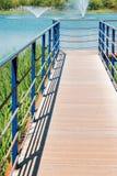 Lake and wooden deck walkway in Bucheon Sangdong Lake Park, Korea. Blue lake and wooden deck walkway in Bucheon Sangdong Lake Park, Korea royalty free stock photos