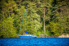Blue lake and yacht Royalty Free Stock Photography