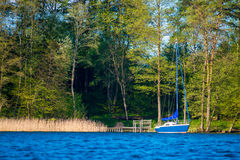 Blue lake and yacht Royalty Free Stock Photos
