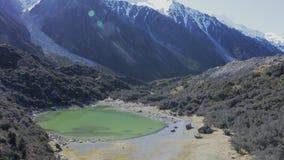Blue lakes and mountains, Tasman Valley Walk and Tasman Glacier View, New Zealand stock video footage