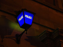 The Blue Lamp. A blue lamp outside a police station at night royalty free stock photo