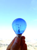 Blue lamp. Hold a blue lamp on blue sky background royalty free stock photos