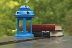 Blue lamp and books Royalty Free Stock Image