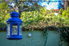 Blue Lamplight. Hanging blue lamplight at the background of a hostel in Skopje Royalty Free Stock Photos
