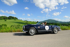 Blue Lancia Aurelia B24 Spider. UMBERTIDE (PG) ITALY - MAY 17: Blue Lancia Aurelia B24 Spider, built in 1955, takes part to the 1000 Miglia historic car race, on stock image