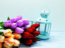 Lantern with artificial flowers bouquet home decoration concept. Blue lantern with artificial flowers bouquet home decoration concept stock photo