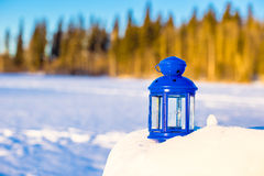Blue lantern with a candle on white snow outdoors Stock Photography