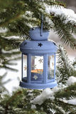 Blue lantern hanging on fir branch. Winter scenery. Royalty Free Stock Images