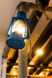 Blue lantern hanging on rope covered pole Royalty Free Stock Photos