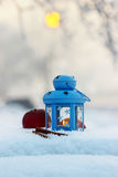Blue lantern in winter scenery Stock Image