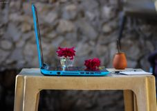 Blue Laptop Computer On Brown Plastic Table stock images