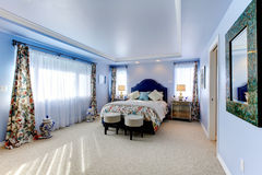 Blue large luxury bedroom with three windows Stock Image