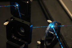 Blue laser beam. With special optics and mirror in a laboratory Stock Images