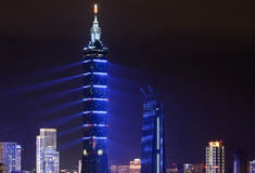 Blue lasers give Taipei 101 a futuristic appearance during a 2017 New Year fireworks and light Royalty Free Stock Image