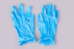 Blue latex medical gloves on white background stock images