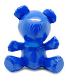 Blue latex toy bear isolated on white background. Blue latex shine toy teddy bear with cyan ribbon isolated on white background royalty free stock images