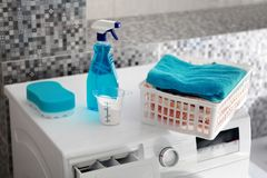Blue laundry powder and washing machine Royalty Free Stock Images