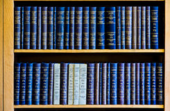 Blue Law Books in Bookshelf. Collection of Permanent Court International of Justice Yearbook in the wooden bookshelf royalty free stock photo
