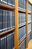 Blue Law Books stacked on the Bookshelf Stock Photos