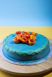 Blue layer cake. Layer cake on a serving plate Royalty Free Stock Photos