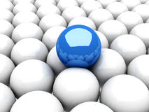 Blue leader sphere standing out of white group Royalty Free Stock Photos