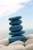 Blue Leaned Pebble Tower. In search of balance Royalty Free Stock Photo
