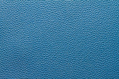 Blue leather. Texture with regular grain pattern Stock Photos